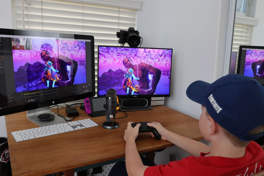 An 11 year-old plays Fortnite featuring Travis Scott Presents: Astronomical concert on April 23, 2020 in South Pasadena, California. Travis Scott + Cactus Jack have partnered with Fortnite to produce Astronomical, a one of a kind in-game experiential performance and the world premiere of a new song.