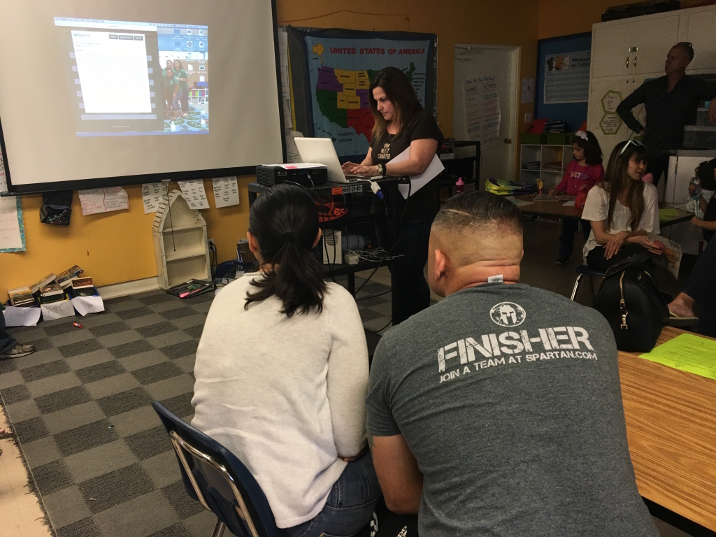 Parents watch as Valley Charter Elementary School's principal conducts a charter lottery to determine which of the 257 families who applied get one of the 28 open slots in the school's kindergarten for the 2016-17 year.