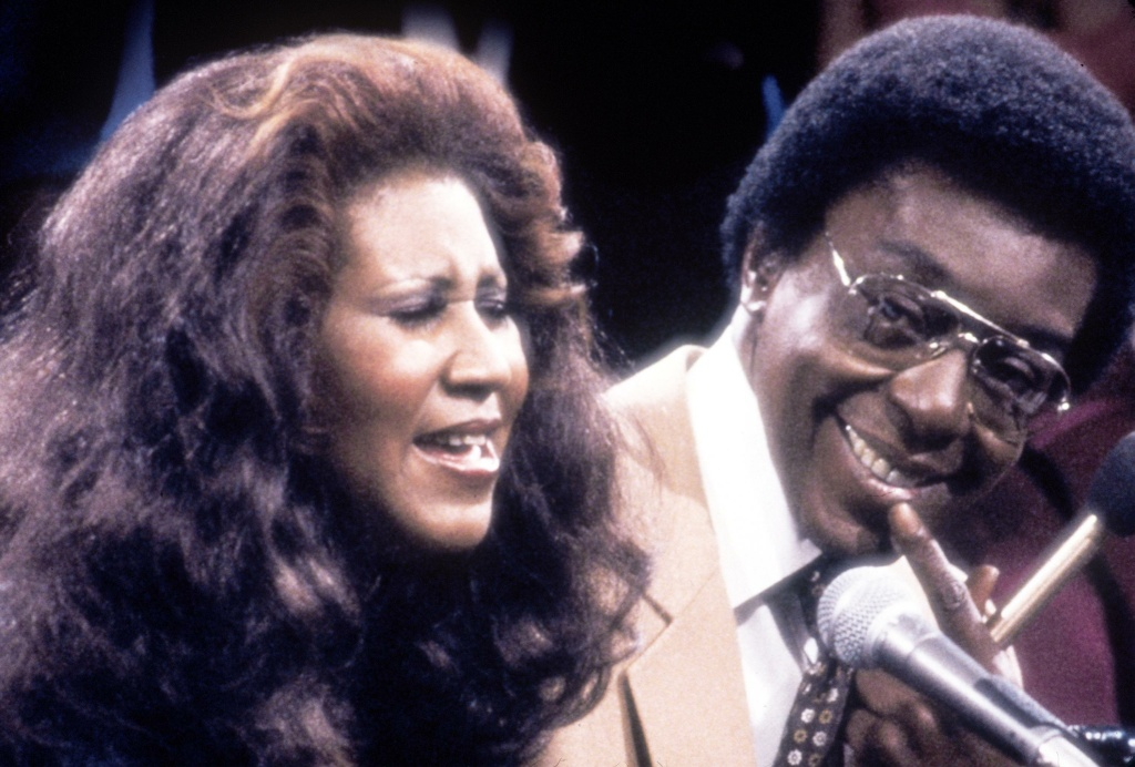Television still of Don Cornelius with Aretha Franklin.