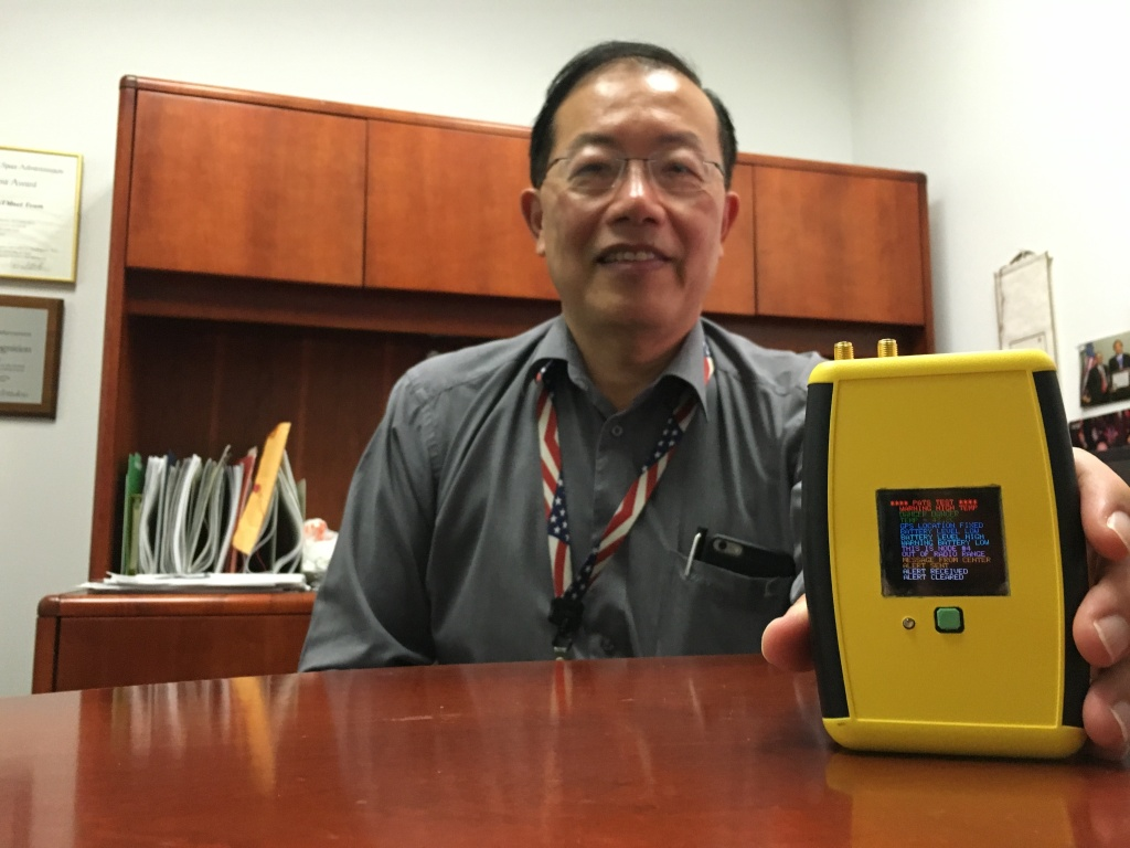 Ed Chow with NASA's Jet Propulsion Laboratory showing off the Personal Alert and Tracking System he helped develop for firefighters.