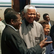 Zimbabwe's President Robert Mugabe, left, greets South African President Nelson Mandela in Harare, Zimbabwe, in 1998. The two men have shaped their countries in dramatically different ways.