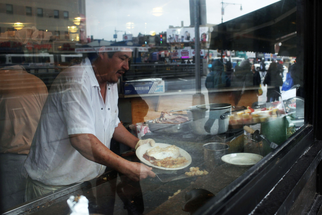 A man cooks eggs on a grill at a dinner on March 15, 2010 in the Bronx borough of  New York. Two recent studies have declared that the Bronx is the least healthy county in the state of New York and home to many of the least healthy residents in the country.