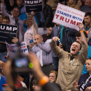 A supporter of Republican presidential candidate Donald Trump heckles demonstrators before the start of a rally at the University of Illinois at Chicago on March 11, 2016 in Chicago, Illinois. The campaign decided to postpone the rally, citing safety concerns, after learning hundreds of demonstrators were given tickets for the event.