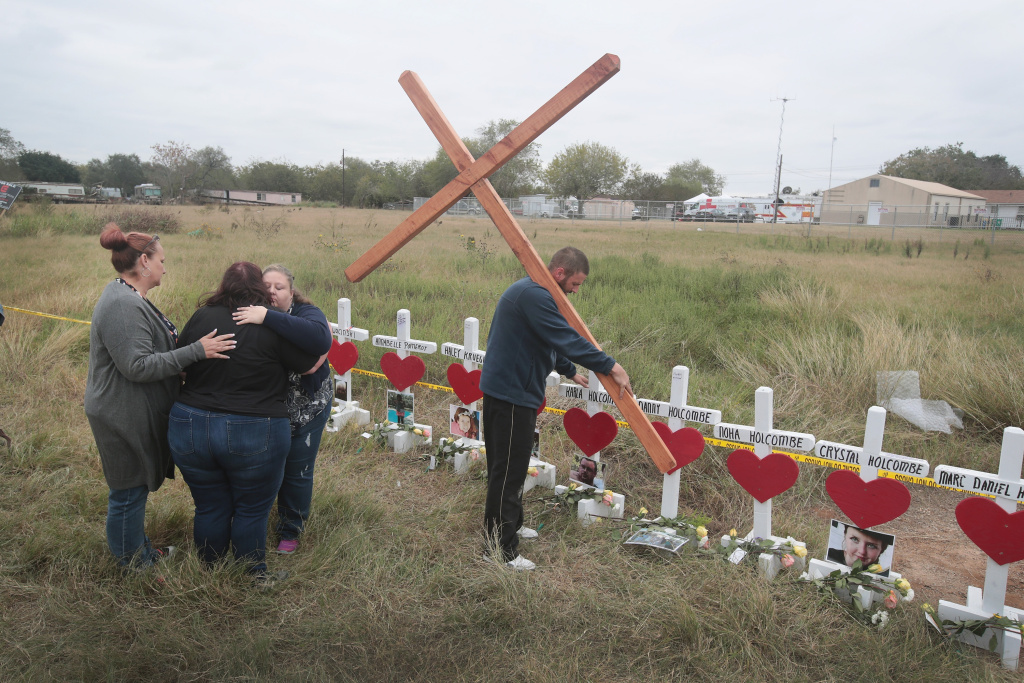 Charlene Uhl is comforted while viewing  a memorial for the 26 people killed by a gunman at the First Baptist Church of Sutherland Springs on November 5, 2017 in Texas.