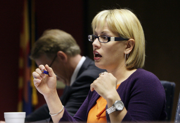 State House Military Affairs and Public Safety Committee member Rep. Kyrsten Sinema, D-Phoenix, asks Sen. Russell Pearce, R-Mesa, a question as he testifies before the committee regarding a possible amendment that makes changes to an immigration bill before the committee at the Arizona State Capitol Wednesday, March 31, 2010, in Phoenix.  The amendment to the bill would ban soft immigration policies in police agencies and prohibit people from blocking traffic when they seek or offer day-labor services on street corners.