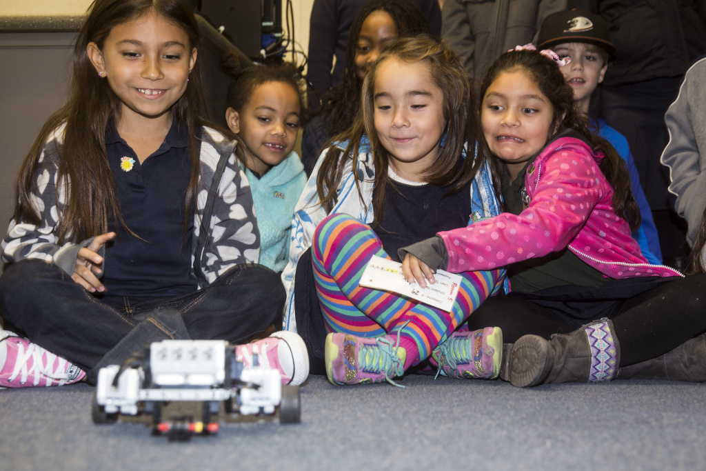 January 8, 2015 - Long Beach, Ca. First graders at Bixby Elementary School in Long Beach, CA.,  react to a robot activated by the class computer code that was created with mindstorm lego robotics in computer lab. LCFF funds are being used to create and support a robotics/computer coding program for students as young as Kindergarten. Photo by Nancy Pastor