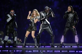 Taboo (far right) performs with his band the Black Eyed Peas at the Super Bowl XLV halftime show on February 6, 2011.