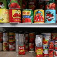 Canned tomatoes line the shelves of a pantry at the SF-Marin Food Bank on May 1, 2014 in San Francisco, California.