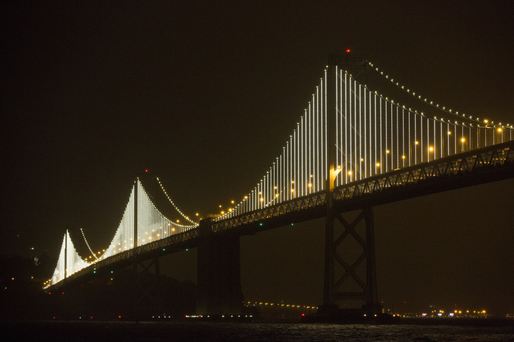 The San Francisco-Oakland Bay Bridge is illuminated with artist Leo Villareal's Bay Lights sculpture on March 5, 2013 in San Francisco.