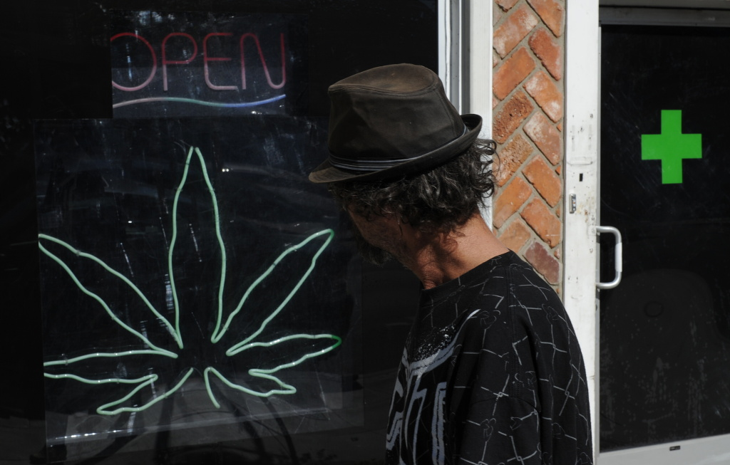 A man walks past a medicinal marijuana dispensary in Los Angeles,CA on November 2, 2010.
