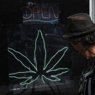 A man walks past a medicinal marijuana d