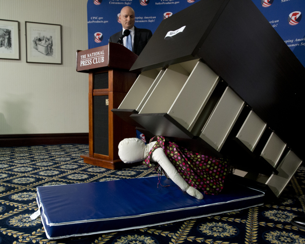 Consumer Product Safety Commission (CPSC) Chairman Elliot Kaye watches a demonstration of how an Ikea dresser can tip and fall on a child during a news conference at the National Press Club in Washington in this June 28, 2016 file photo. Ikea is recalling 29 million chests and dressers after six children were killed when the furniture toppled over and fell on them.