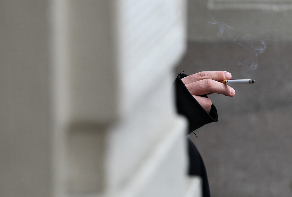 A smoker holds a cigarette on May 31, 2011 in San Francisco, California.  Since 1987, the World Health Organization has celebrated