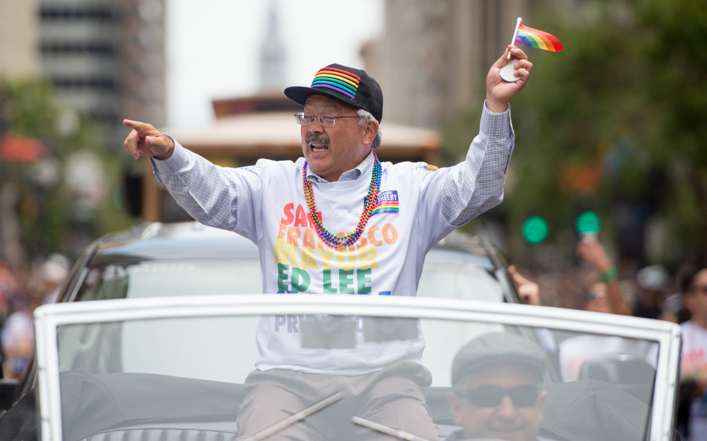 San Francisco Mayor Ed Lee waves to a cheering crowd during the San Francisco Pride Parade in San Francisco, California on Sunday, June, 25, 2017.