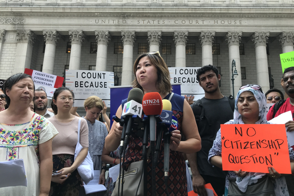 Rep. Grace Meng, D-N.Y. (center) held a press conference earlier this month outside Manhattan federal court with Liz OuYang (left) of the New York Immigration Coalition and other critics of the new citizenship question on the 2020 census.