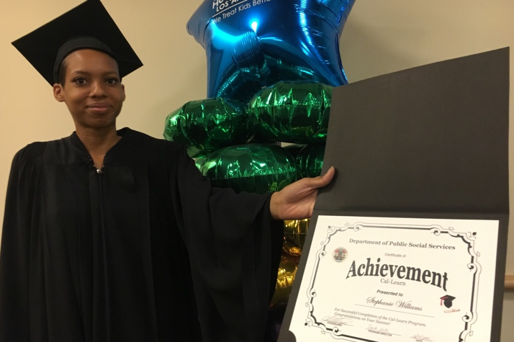 Stephanie Williams, 20, celebrating the completion of her high school diploma in June 2016 through Project NATEEN's independent study program for young parents. The program is run through Children's Hospital Los Angeles and has been operating for 30 years.