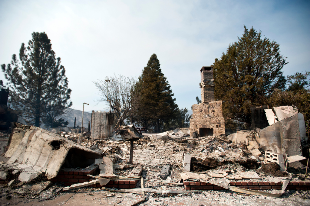 A Lake Hughes home on Newview Road is one of several homes that have been destroyed by the Powerhouse Fire, which started on Thursday afternoon and has since burned thousands of acres.