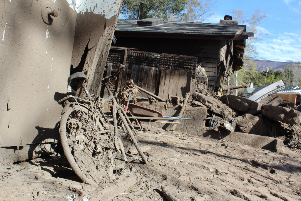 A bike caked in mud stands in the wreckage of a debris flow in Montecito on Thurs., March 8, 2018.