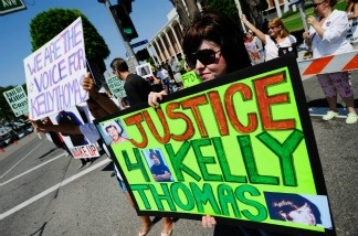 Demonstrators protest the death of Kelly Thomas, a homeless man who died after an altercation with several officers, on August 20, 2011.
