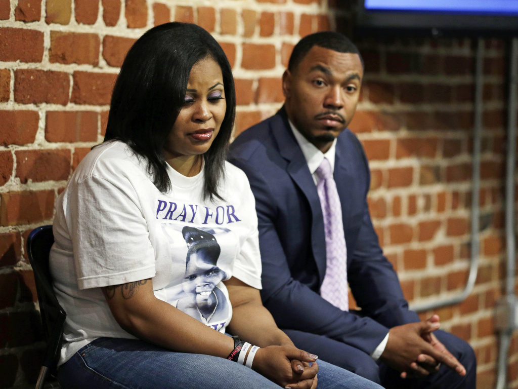 Nailah Winkfield (left) and Omari Sealey, the mother and uncle of Jahi McMath, listen to doctors speak during a news conference in San Francisco in 2014.