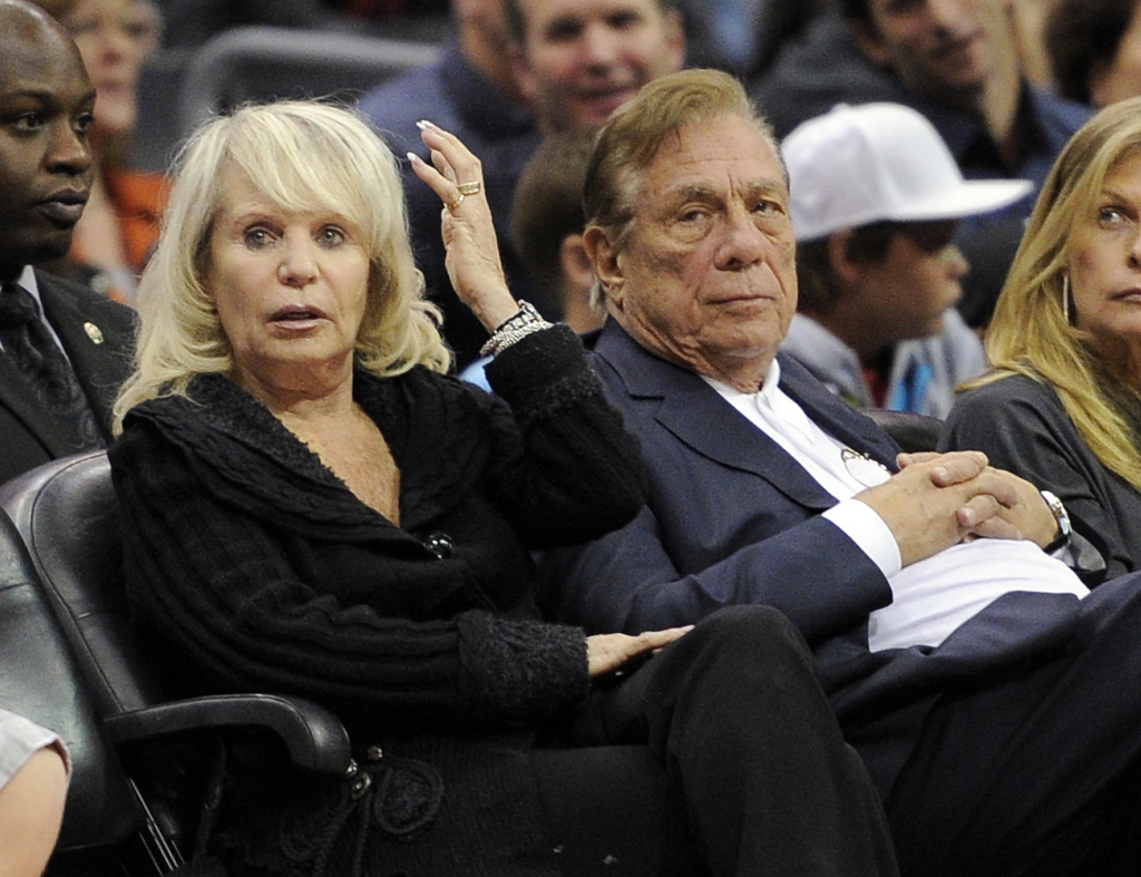 Shelly Sterling sits with her husband, Donald Sterling, during the Los Angeles Clippers' NBA basketball game against the Detroit Pistons in Los Angeles.