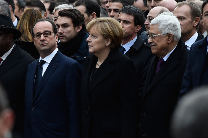 Demonstrators make their way along Place de la Republique during a mass unity rally following the recent terrorist attacks on January 11, 2015 in Paris, France. An estimated one million people have converged in central Paris for the Unity March joining in solidarity with the 17 victims of this week's terrorist attacks in the country. French President Francois Hollande led the march and was joined by world leaders in a sign of unity. The terrorist atrocities started on Wednesday with the attack on the French satirical magazine Charlie Hebdo, killing 12, and ended on Friday with sieges at a printing company in Dammartin en Goele and a Kosher supermarket in Paris with four hostages and three suspects being killed. A fourth suspect, Hayat Boumeddiene, 26, escaped and is wanted in connection with the murder of a policewoman.