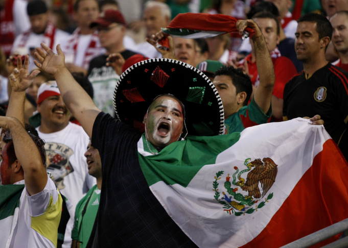 Mexico fans cheer before the start of the Brazil 2014 FIFA World Cup qualifier against USA at Columbus Crew Stadium in Columbus, Ohio, September 10, 2013. USA won 2-0.