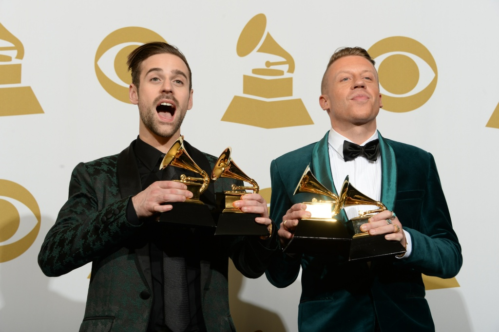 Macklemore (R) and Ryan Lewis pose with their awards in the press room during the 56th Grammy Awards at the Staples Center in Los Angeles on January 26, 2014.