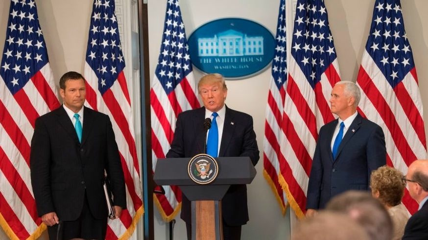 President Trump, flanked by Kansas Secretary of State Kris Kobach and Vice President Pence, speaks during the first meeting of his Presidential Advisory Commission on Election Integrity in July.