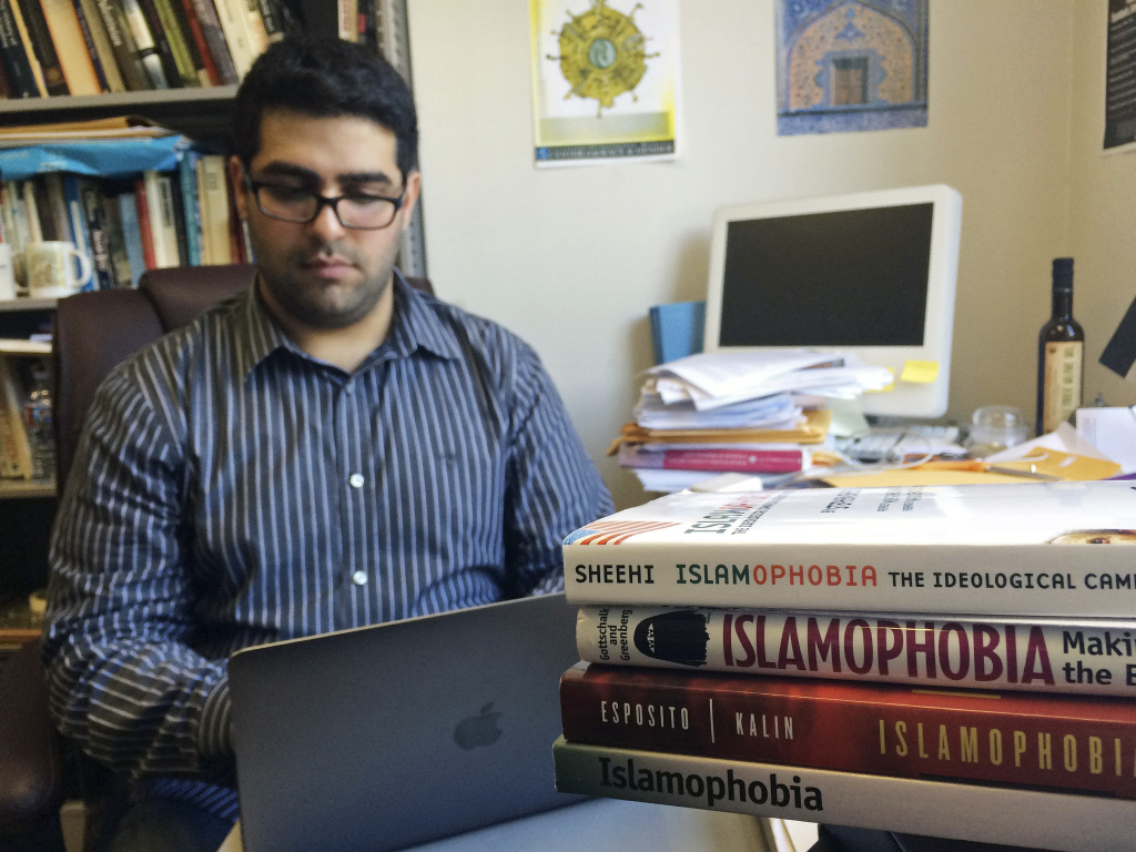 Khairuldeen Makhzoomi works in his office in Berkeley, Calif., Monday, April 18, 2016. A University of California, Berkeley student who came to the U.S. as an Iraqi refugee says he was unfairly removed from a flight at Los Angeles International Airport earlier this month because a fellow passenger was alarmed by an innocent conversation he was having in Arabic. Southwest Airlines said in a statement Sunday that the passenger, Makhzoomi, was taken off the April 9, 2016, flight from Los Angeles to Oakland, California, for questioning and the plane took off while that was happening. (AP Photo/Haven Daley)