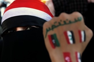 A Yemeni fully veiled youth, shows her f