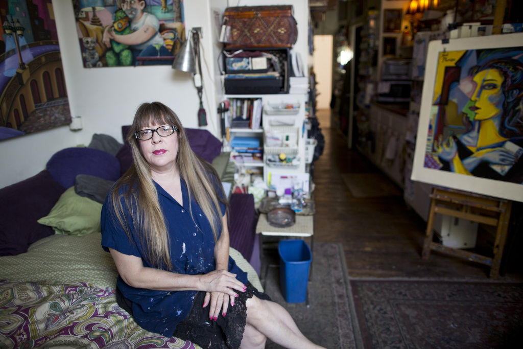 Artists say they are getting pushed out of neighborhoods they made popular. Painter Jett Jackson sits in her 275-square-foot live and work space in the Arts District in 2015.