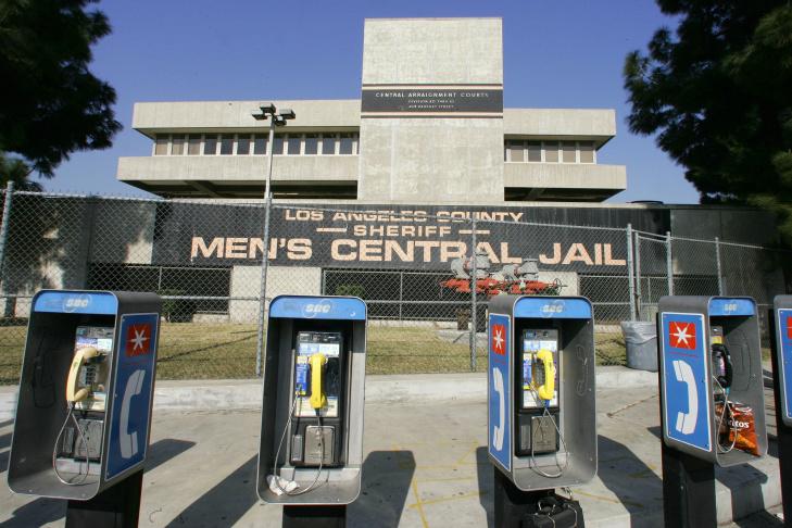 A bank of public phones outside Men's Ce