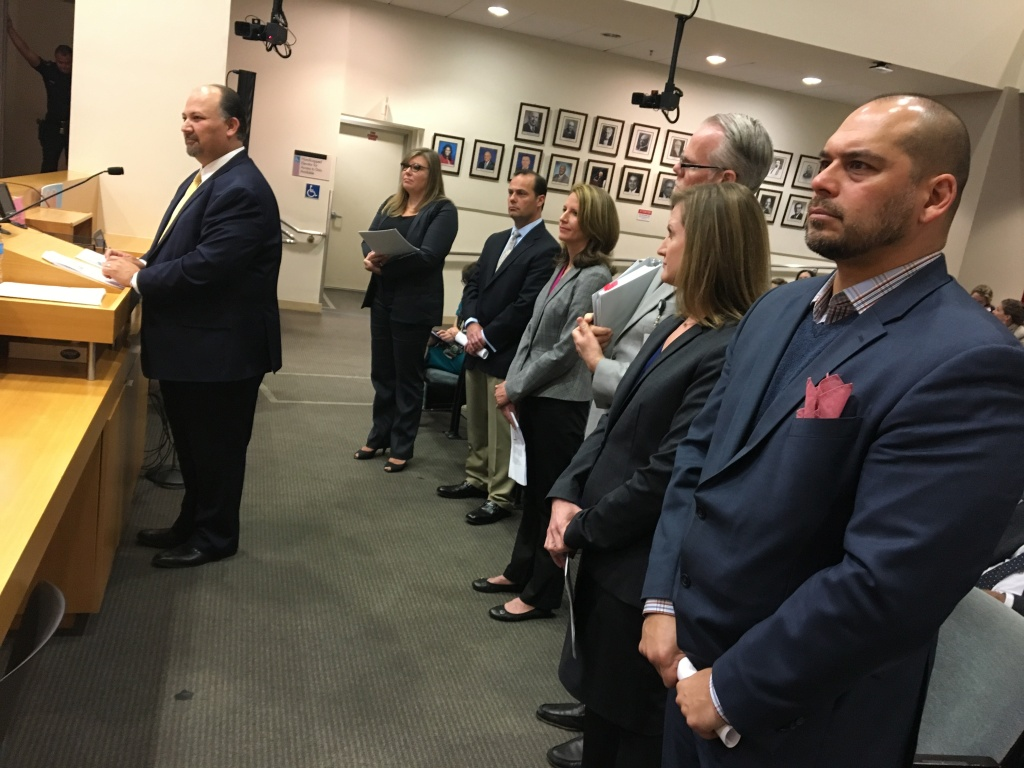 Members of a working group of Los Angeles Unified School District officials and charter school leaders stands before the district's school board on Tues., April 3, 2018.