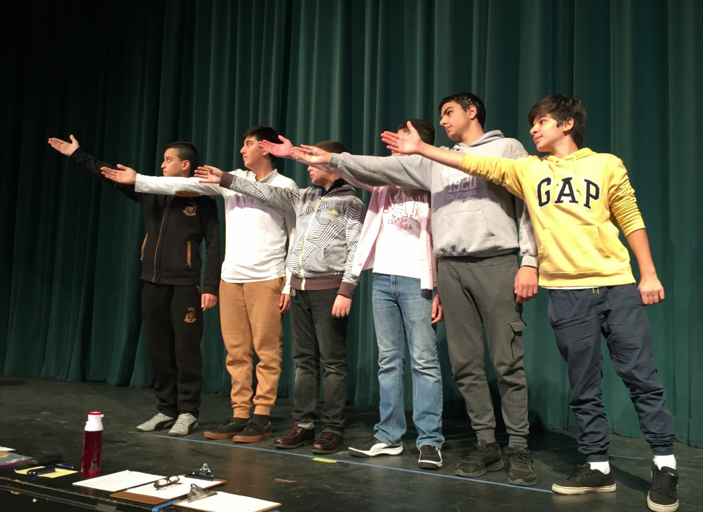 Students in the English Language Development class at John Muir Middle School rehearse for a poetry performance.