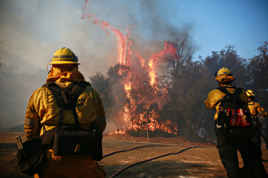 Firefighters battle flames from the Woolsey fire on Nov. 10 at the Salvation Army Camp in Malibu.