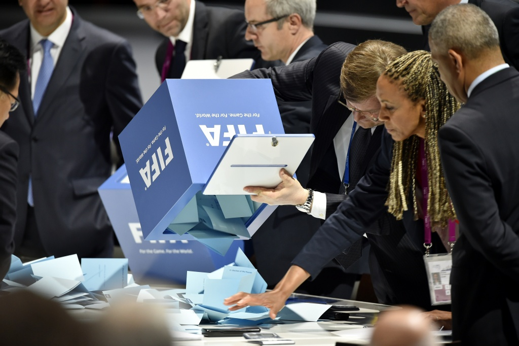 Officials open ballot boxes as vote counting got underway following the vote to decide on the FIFA presidency in Zurich on May 29, 2015.   Sepp Blatter, 79, is being challenged by Prince Ali bin al Hussein, a FIFA vice president. The prince, strongly backed by Europe's football powers, has campaigned on the need for change at the top of the scandal-tainted body.  AFP PHOTO /  FABRICE COFFRINI        (Photo credit should read FABRICE COFFRINI/AFP/Getty Images)