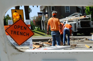 City of Los Angeles Public Works Department Street Services workers repair a sidewalk on August 12, 2010 in Los Angeles, California.