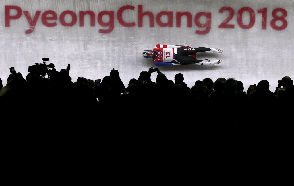 The crowd watches the men's luge competition at the 2018 Pyeongchang Winter Olympics.