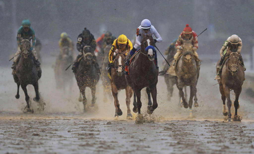 Mike Smith rides Justify to victory during the 144th running of the Kentucky Derby horse race at Churchill Downs Saturday, in Louisville, Ky.