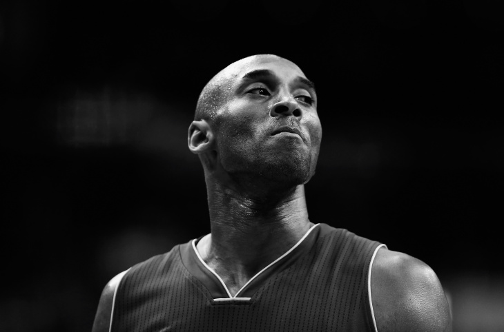 Kobe Bryant #24 of the Los Angeles Lakers looks on against the Washington Wizards in the first half at Verizon Center on December 2, 2015 in Washington, DC. (Editors Note: Image has been converted to black and white)