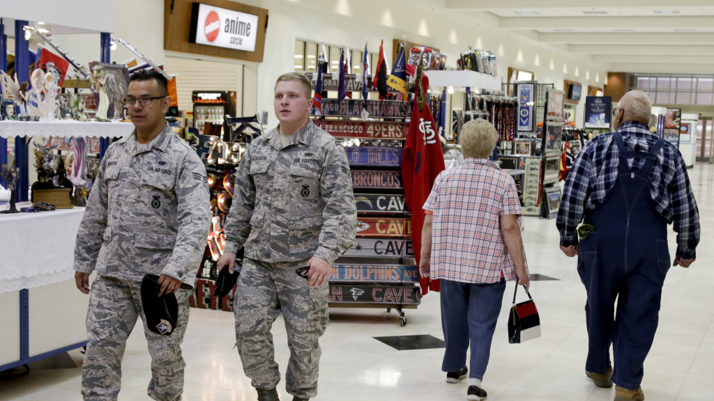 Soldiers and civilians walk through a store on Offutt Air Force Base in Nebraska in 2017. The Army and Air Force Exchange Service, which oversees military retail facilities, recommended this week that stores show sports instead of news on their common-area televisions.