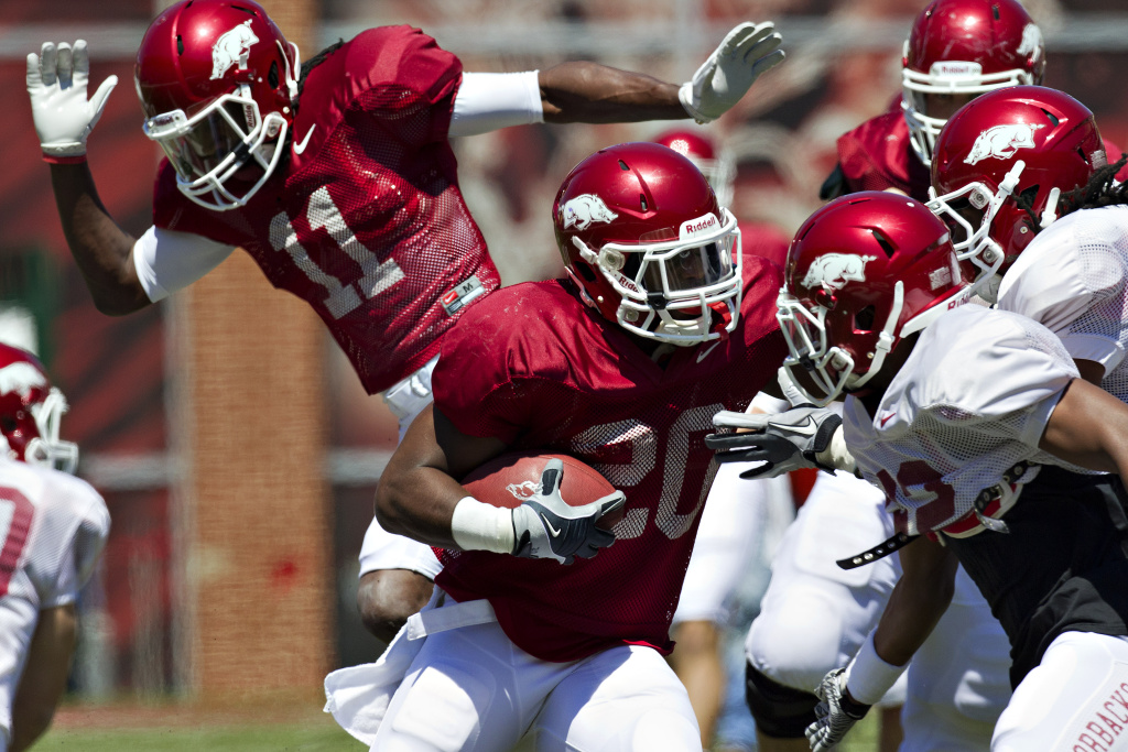 Ronnie Wingo Jr. #20 of the Arkansas Razorbacks Red Team runs the ball during the Spring Game at Donald W. Reynolds Stadium on April 21, 2012 in Fayetteville, Arkansas.