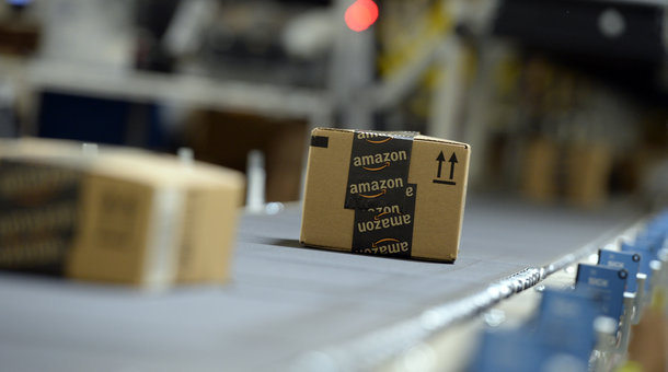 Shipping orders go by on a conveyor belt at Amazon's San Bernardino Fulfillment Center October 29, 2013 in San Bernardino.