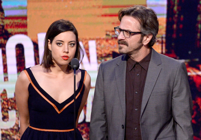 Actress Aubrey Plaza and comedian Marc Maron speak onstage during the 2014 Film Independent Spirit Awards at Santa Monica Beach on March 1, 2014 in Santa Monica.