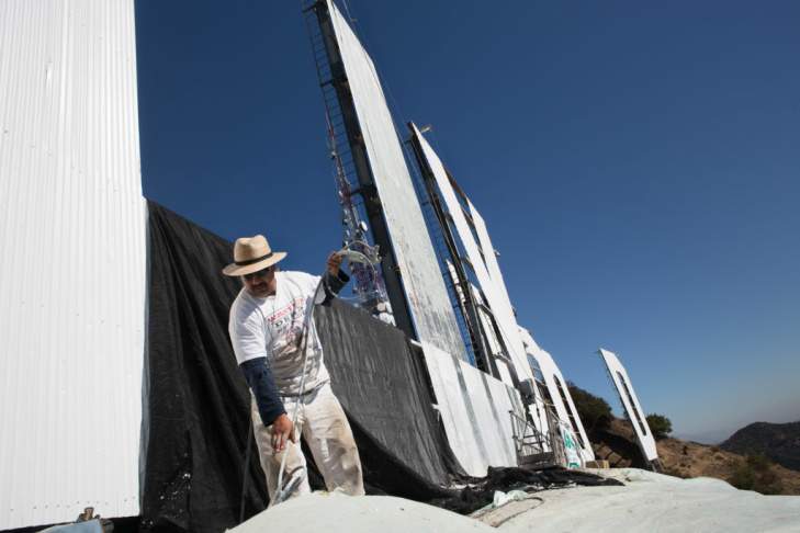 Painters prime the Hollywood sign in Los Angeles. The crew started working on the project on October 2, 2012.