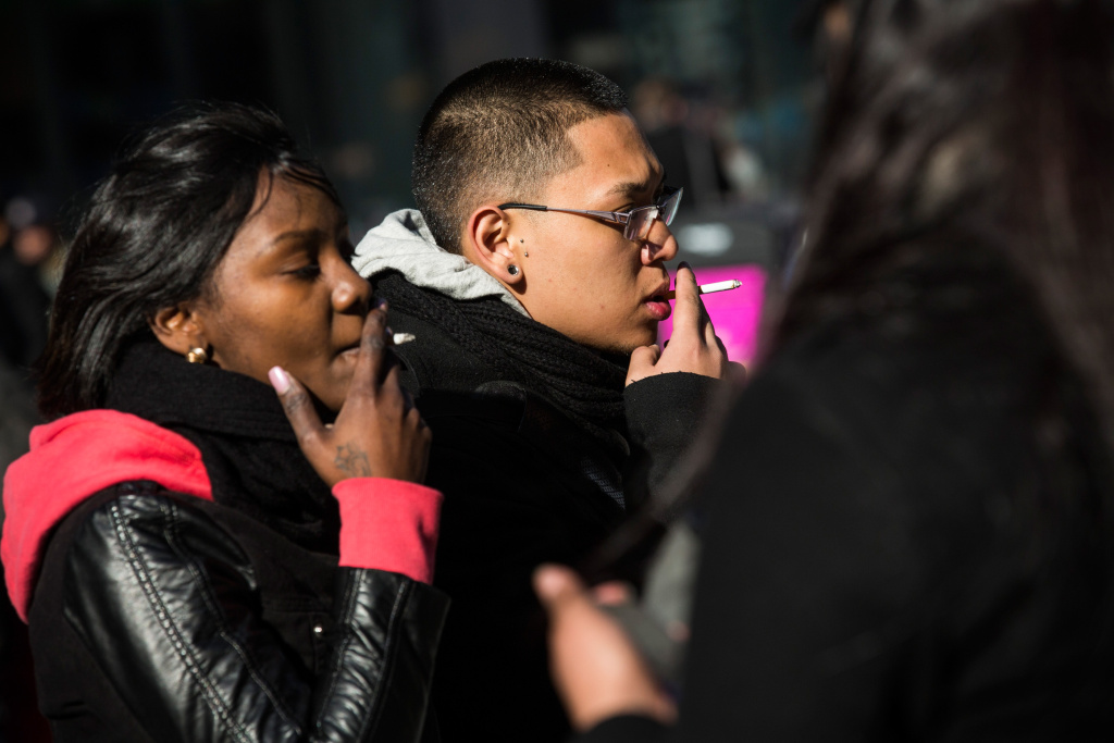 A man and woman smoke cigarettes on January 17, 2014 in Times Square in New York City.