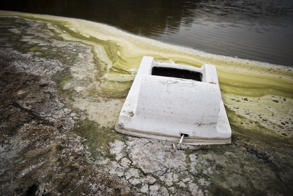 A sunken boat lies in the mud near the receding water line of Lake Hughes north of Santa Clarita. California Gov. Jerry Brown's office announced a news conference for Thursday, March 19, 2015, at the state Capitol to present new emergency drought-relief legislation, but it released no details of the plan.