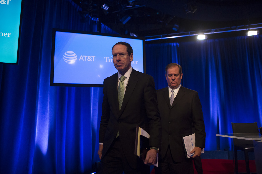 AT&T Chairman and CEO Randall Stephenson and AT&T Senior Executive Vice President David R McAtee II  leave after a  news conference in Time Warner headquarters addressing the latest developments in the AT&T and Time Warner merger on November 20, 2017 in New York City.