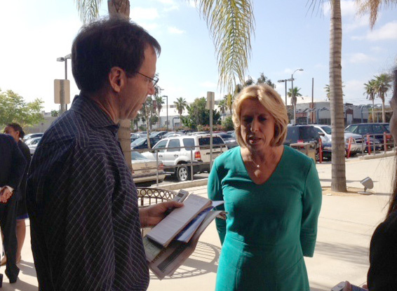 Mayoral candidate Wendy Greuel talks with Los Angeles Times reporter Jim Rainey outside West Angeles Church.